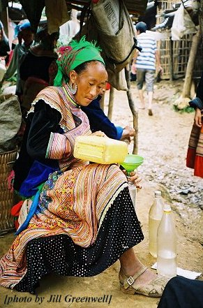 Pouring rice wine, Cocly market, Vietnam